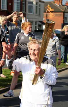 90 year-old, Olympic Torchbearer Margaret Bishop carries the Olympic Flame on the Torch Relay leg through Hull. #olympics