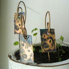 copper wire from Home depot and sheet metal to hang make cute plant markers