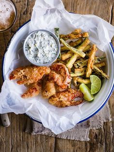 Put a sophisticated modern twist on the classic British fish and chips with this recipe for lobster goujons with courgette fries.