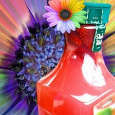 Hippie Juice- Rinse Simply brand Juice Container. Then use the funnel to neatly pour 4 scoops of Country Time Pink Lemonade into the container. Next, measure out 1 cup of Smirnoff brand Watermelon Vodka, 1/3 cup Triple Sec, and 1/3 cup Malibu Coconut Rum into a measuring cup and use the funnel to add your mixture. Using cold water, fill the rest of the container up to the base of the neck.