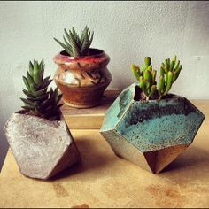 Two on the right are glazed stoneware, the left one is cast concrete.
