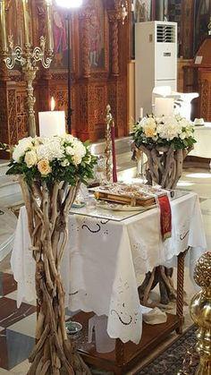Λαμπάδες γαμου σε θαλασσοξυλα με ορτανσία τριαντάφυλλα και λυσιανθο