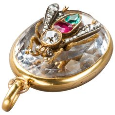 Russian Ruby Emerald Diamond Gold Gadfly Locket circa 1890 | From a unique collection of vintage drop necklaces at https://www.1stdibs.com/jewelry/necklaces/drop-necklaces/