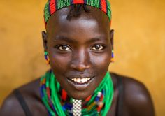 https://flic.kr/p/V8fSNU | Portrait of a beautiful smiling Hamer tribe woman, Omo valley, Dimeka, Ethiopia | © Eric Lafforgue www.ericlafforgue.com