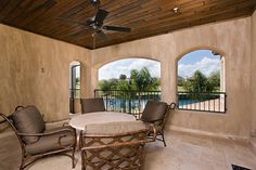 Patio balcony with relaxing pool view in this Florida vacation home