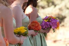 Each bridesmaid has one color from brides bouquet.