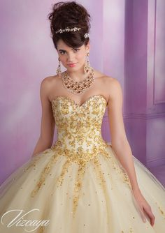 Quinceanera dresses by Vizcaya 89015 Embroidered Tulle Quinceanera Gown with Beading Bolero Jacket. Corset Tie Back. Colors Available: Stiletto/Gold, Deep Purple/Gold, Champagne/Gold, White/Gold. Sizes Available: 0-24.