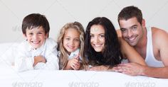 United family having fun together on the bed at home ...  30s, Mid Adult, affection, beautiful, bed, bedroom, boy, caucasian, cheerful, child, concept, cuddling, dad, daughter, down, embracing, family, father, female, fun, girl, happy, having, home, hugging, indoor, kids, laughing, life, lifestyle, love, lying, male, man, mixed-race, mom, morning, mother, offspring, parent, play, playful, relaxing, sibling, smile, son, togetherness, woman