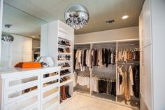 Walk in closet with mirrored dresser drawer fronts