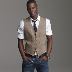 Collared shirt, jeans and a vest. Make sure the jeans fit well or it just looks sloppy