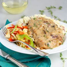 These Baked Mushroom Pork Chops are seasoned, breaded, and seared before being baked to perfection under a succulent wine and mushroom thyme sauce.  There are those dishes that are beautiful and ta...