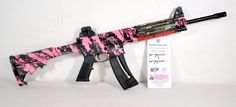 "Smith & Wesson M&P15-22 Pink Platinum .22 LR. Chambered in .22LR, the M&P15-22 is an AR15-style rifle. It features a 6-position collapsible stock; lightweight high-strength polymer upper and lower receiver with integral steel inserts; adjustable rear and front sights; two-position safety; quad rail handguard; and threaded barrel made from carbon steel. Pink Platinum camo finish. 25-round capacity of .22 LR. 16.5"" barrel. 5.5 lbs. [New in Box] $469.99"