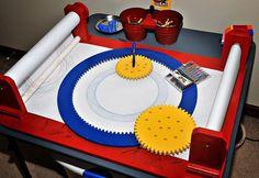 Make a big Spirograph! http://blog.makezine.com/2010/09/21/diy-spirograph-machine/