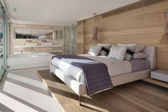 ES Roca Llisa: A modern villa located on the island of Ibiza. The architecture combines contemporary elements with natural materials. Interior by ARRCC. African Bedroom, Villa Design, Cool House Designs, Modern Bedroom, Wood Bedroom, Bedroom Bed, Bedroom Ideas, Master Bedroom, Luxury Living