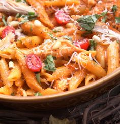 Roasted red pepper and basil pesto:  2 cloves garlic  1/3 cup freshly grated mozzarella   1 of jar (or can 8oz each) roasted red bell peppers, drained  1 (8oz) can  1 cup fresh basil leaves  salt and pepper  1 pound penne pasta  roasted chicken  fresh tomatoes