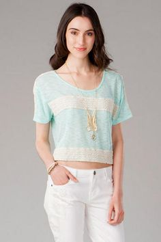 Sweet, lacy crop is perfect with a simple long necklace and dark blue jeans.