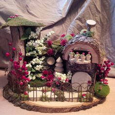 A wintery bright berry and blissful house awaits a very special fairy. With lush berries amd winter white foliage, this house has some sweet
