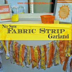 No-Sew Fabric Strip Garland-what a great, cheerful garland! It won't be hard to find cute fabric to put together this quick and easy garland-and it will be cheap, too. Perfect for a baby shower or nursery decor!