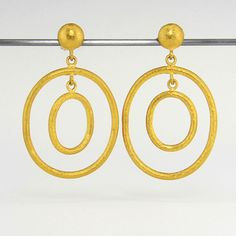 "A pair of 24k yellow gold, rachel double loop earrings with a round post top. Total length measures 1.5"" by Yossi Harari"