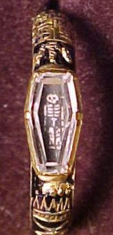 Mourning Ring with a skull painted under the crystal. Gold, crystal, and enamel. Private collection.
