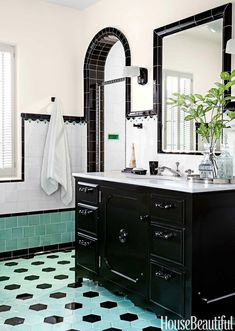A black vanity topped with honed Calacatta Luna marble anchors the boy's bathroom. Glass pulls and knobs by House of Antique Hardware. Porcher's Mesa sink and THG faucets. - April 13 2019 at Black Vanity Bathroom, White Bathroom, Small Bathroom, Black Bathrooms, Tile Bathrooms, Country Bathrooms, Tub Tile, Bathroom Accents, Bathroom Closet