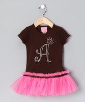 This twirl-worthy tee offers a stretchy fit with tulle skirting that can easily be worn for everyday play or special occasions. Embellished with sparkling rhinestones in the form of an initial, this pretty one-piece makes the perfect gift.Personalize with initialTee: 100% cottonTrim: 100% nylon tulle