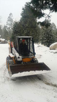 Shoving snow around at Pine Rose Cabins!  Happy New Year!