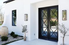 Black and White Exterior Front Entrance by Scheffy Construction featuring a stunning and a facade. Credit to for the use of the image. Design Exterior, Exterior Paint, Interior And Exterior, Door Design, Glass Front Door, Iron Front Door, Front Entry, Glass Door, Black Doors