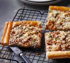 Top puff pastry with tangy mustard, onions and Parmesan cheese for a light vegetarian lunch or party buffet nibble