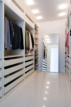 Great storage for a walk in wardrobe, love the amount of hanging space and draw space.  Also love the mirror at the end.