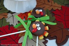 OREO Turkey Pops Recipe & Instructions on HoosierHomemade.com. Ingredients: Oreos, chocolate candy coating, lollipop sticks, candy corn, red and orange starburst fruit chews, candy eyes