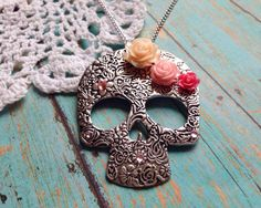 A personal favorite from my Etsy shop https://www.etsy.com/listing/261691390/large-sugar-skull-necklace-with-pink