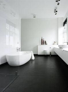 possible design of bathroom. Don't like the dark floor but the no frame shower, bath and basin units aren't bad?
