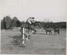 Student on horseback performing a jump :: Archives & Special Collections Digital Images :: circa 1955-1959