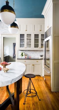 Drooling over the Visual Comfort Hicks pendants today.  Came across this lovely kitchen.  Brass hardware, carerra marble, and colorful ceiling.  What's not to love?