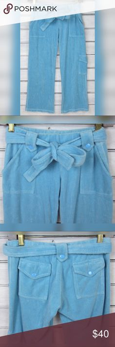 Juicy Couture Blue Terry Belted Cargo Capri Pants 100% authentic Juicy Couture light blue terrycloth cargo capri pants! Features a belted tie at the waist, slanted tuck pockets at the hips, back flap cargo pockets and a pocket on the outside of the thigh! Low rise, cropped length hits mid-calf on most wearers. Made in the glamorous USA!   Size P (XS).  80% Cotton 20% Polyester.   Excellent condition overall, only worn a few times-no visible signs of notable wear or damage, smoke free home…