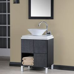 A simple, yet elegant vanity for a half bathrooom.  Call Griggs Building and Design Group at 989-835-8601 or visit us at www.griggsbuilding.com