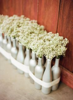 baby's breath in painted glass bottles