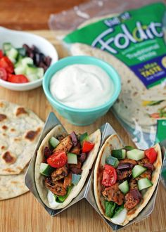 These easy Greek Chicken Tacos are packed with fresh flavor, seasoned chicken & a Feta-yogurt spread for 138 calories or 3 Weight Watchers SmartPoints each! www.emilybites.com