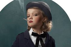 "There is definitely a bit of sense of humor in the Smoking Kids series of photograhps by Frieke Janssens. With the tobacco industry's push toward attracting children to consume their products, Janssens has theatrically staged and costumed his kids to act the part of ""sophisticated"" adults enjoying a good smoke."