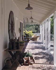 A breezeway links the main house, garage, and offices and provides protection from the sun and afternoon winds in this farmhouse-style retreat. Landscape design by Scott Lewis
