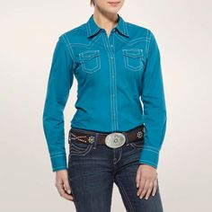 The Miranda is a classic women's western shirt in an energetic monochrome color. Tailored from solid poplin with contrast stitching, snap closures and a western yoke. Greater Arm Mobility Technology provides comfort and freedom of movement.