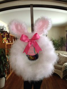 Foam circle wrapped with a white feather boa hobby lobby bunny ears and pink ribbon. Easter Tree, Easter Wreaths, Christmas Wreaths, Spring Crafts, Holiday Crafts, Easter Bunny Ears, Hobby Lobby Christmas, Feather Wreath, Dollar Tree Crafts