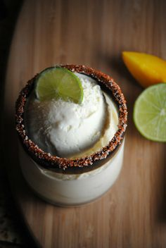 I don't like homemade ice cream but this sounds and looks scrumptious....Mango Margarita Ice Cream