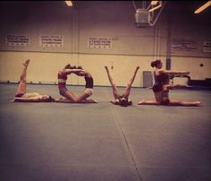 Gymnasts spelling the word LOVE, gymnastics