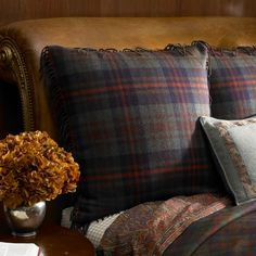 cozy bed with tartan pillows from coffeepearlsandpoetry