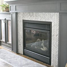 The fireplace surround is done! WHOOT!! A tutorial and more pics on the blog. #linkinprofile #ineedanap  Peppercorn paint with herringbone tile.