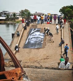 #TBT Pasting on a broken bridge in Monrovia Liberia portraits of women victim from the conflict... The rebels that were controlling the bridge ended up helping us pasting even if they were the ones responsible for the chaos in the city #2007 @emile by jr