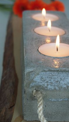 Wooden winebox made a great mold for this concrete tea light holder