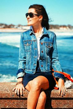 Denim jacket, collar and sleeves turned up and sunglasses. A great weekend look.